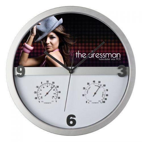 Reloj de pared con higrómetro y termómetro.